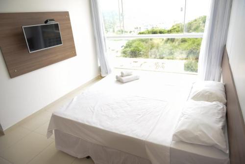 A bed or beds in a room at Pousada Xerxes