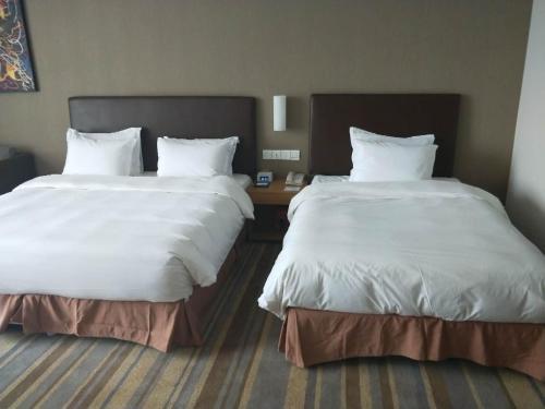 Кровать или кровати в номере Holiday Inn Express Ordos Dongsheng