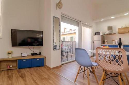 A television and/or entertainment centre at Apartment Ma Vi