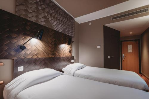 A bed or beds in a room at Ibis Casablanca City Center