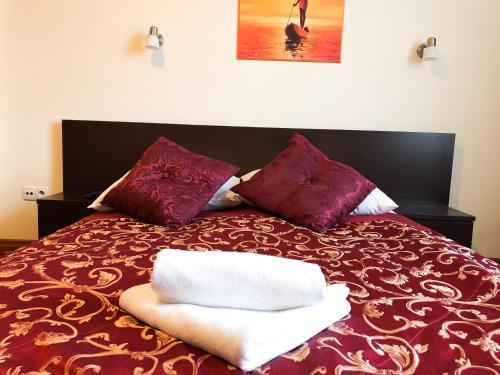 Łóżko lub łóżka w pokoju w obiekcie Hotel Korona