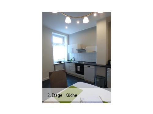 A kitchen or kitchenette at Ferienwohnung Trier Stadtmitte/Fußgängerzone