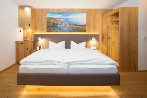 Ein Bett oder Betten in einem Zimmer der Unterkunft Hotel Restaurant Seehalde