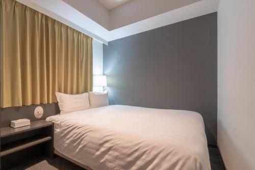 Letto o letti in una camera di E Hotel Higashi Shinjuku