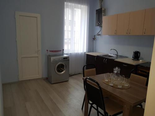 A kitchen or kitchenette at V. Apartment