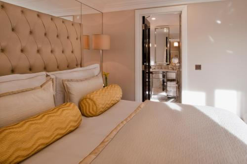 A bed or beds in a room at The Wellesley Knightsbridge, a Luxury Collection Hotel, London