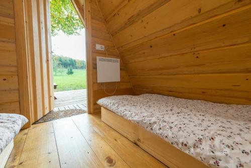 Postelja oz. postelje v sobi nastanitve Glamping Village - Speleo Camp