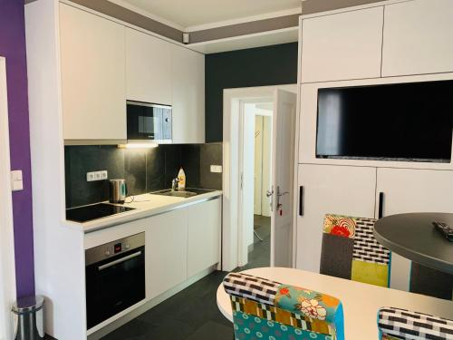 A kitchen or kitchenette at Apartment Sejko