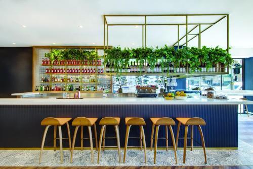 Лаундж или бар в Vibe Hotel Sydney
