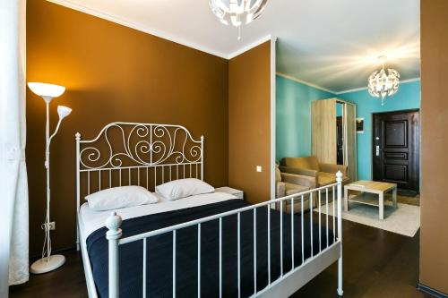 A bed or beds in a room at MaxRealty24 UP-kvartal 4