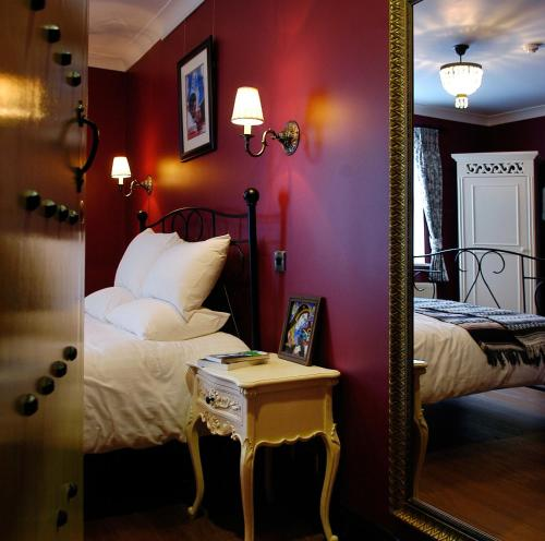 A bed or beds in a room at Church Street Hotel