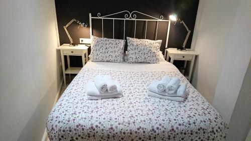 Cama o camas de una habitación en Apartamentos PuntoApart Cerrojo