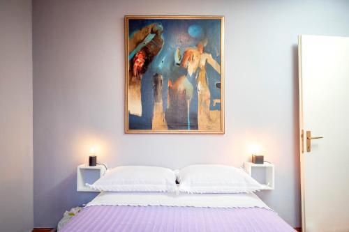A bed or beds in a room at Apartment Bosiljak