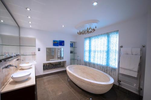 "A bathroom at Cotswold House Hotel and Spa - ""A Bespoke Hotel"""