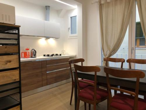 A kitchen or kitchenette at San Frediano Apartment