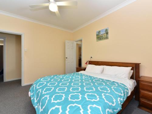 A bed or beds in a room at Church View Cottage in central Broke, close to Wedding venues