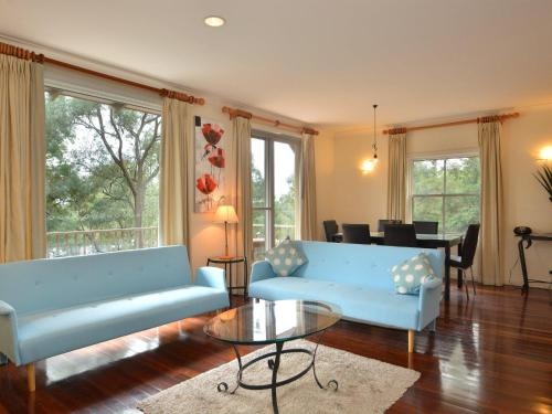 A seating area at Villa 2br Chardonnay SS located within Cypress Lakes Resort (nothing is more central)