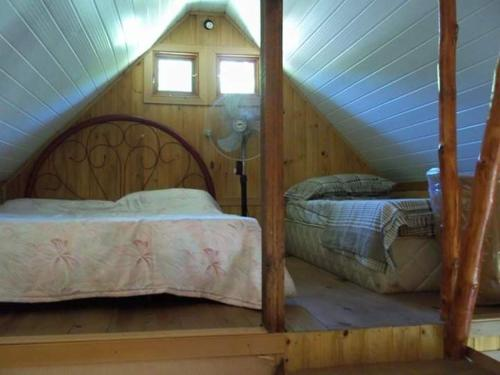A bed or beds in a room at Refúgio Mãe Natureza