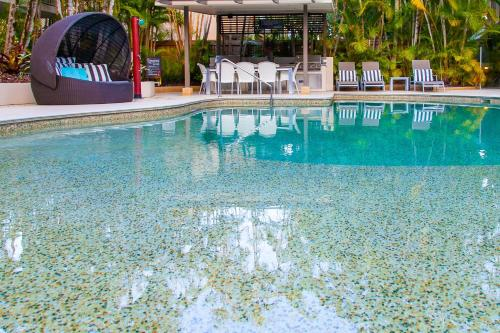 The swimming pool at or near Noosa Tropicana