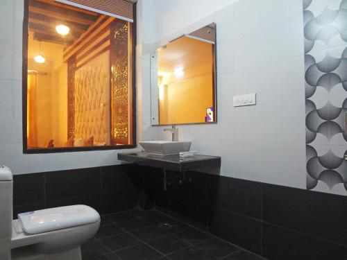 A bathroom at Hill House Manali -A home in mountains