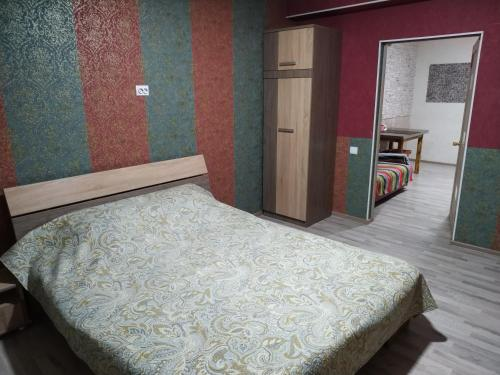 A bed or beds in a room at Milo Apart Hotel