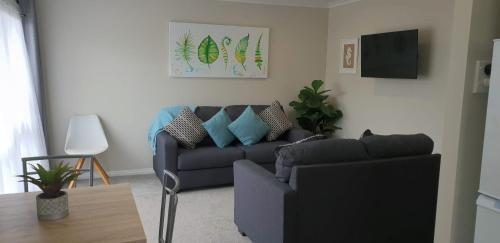 A seating area at Rose Apartments Unit 6 Central Rotorua-Accommodation & Spa