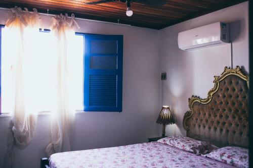 A bed or beds in a room at Pousada Nel Blu