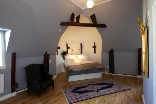 Säng eller sängar i ett rum på Hotell Hjalmar