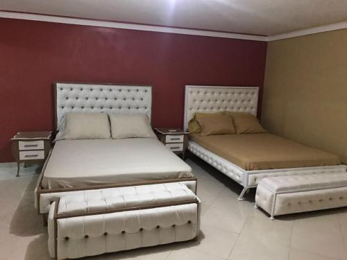 A bed or beds in a room at LA CASA guest house and bar