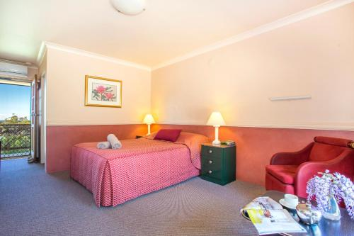 A bed or beds in a room at Milton Village Motel