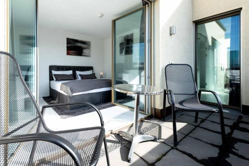 A balcony or terrace at iQ130 Apartment Hotel