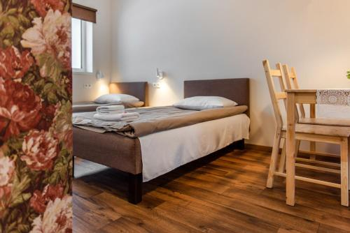 A bed or beds in a room at Bestes apartamenti