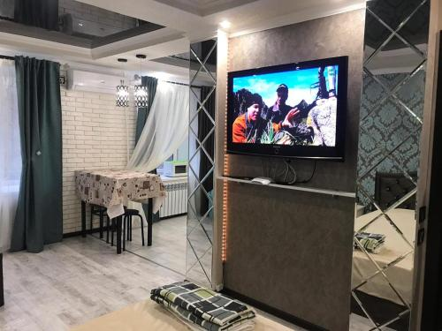 A television and/or entertainment center at Улица Ленина 58А