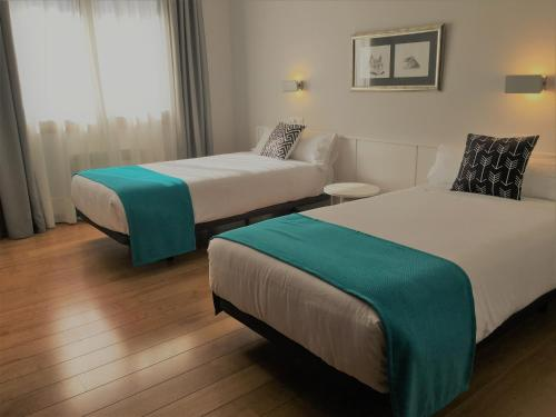 Кровать или кровати в номере Hotel Elorrio