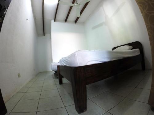 Un ou plusieurs lits dans un hébergement de l'établissement Tsunami Hostel