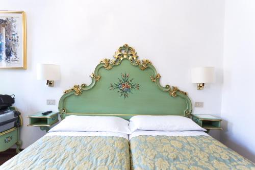Letto o letti in una camera di Hotel Serenissima
