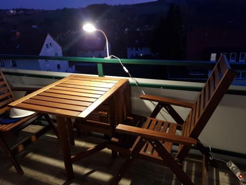 """A balcony or terrace at Ferienwohnung """"HAGEBUTZE"""" mit Sauna und Schwimmbad"""