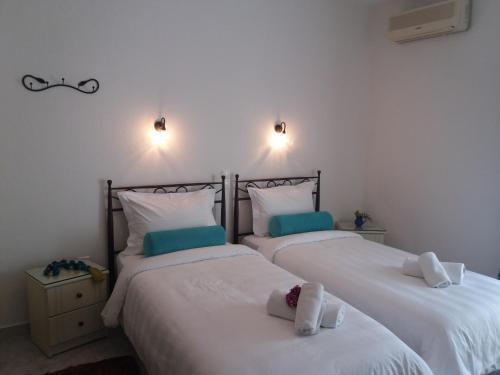 Ένα ή περισσότερα κρεβάτια σε δωμάτιο στο Pansion Irini