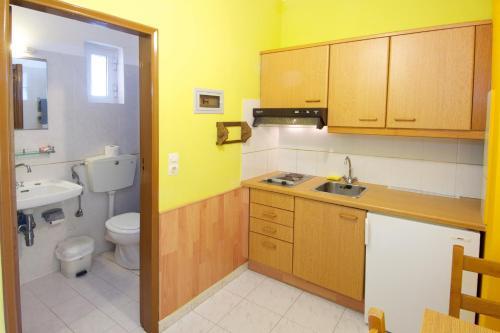 Η κουζίνα ή μικρή κουζίνα στο Remezzo Apartments