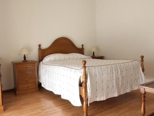 A bed or beds in a room at Alojamento Local Dom Dinis