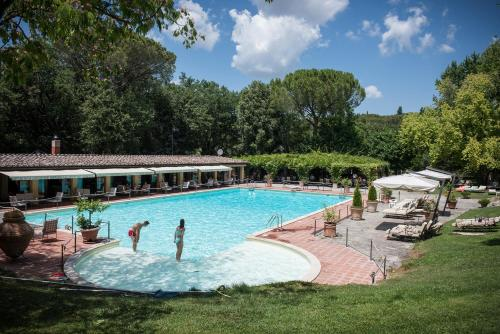 The swimming pool at or near Borgo San Luigi