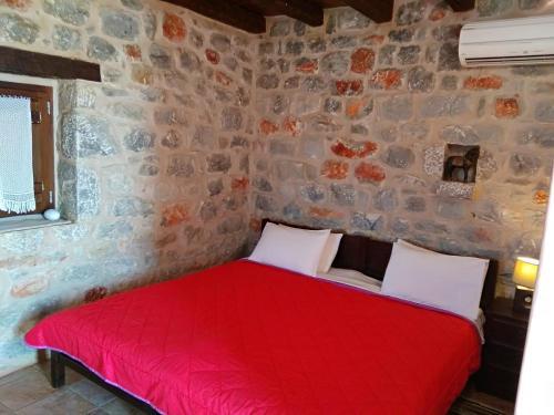 Ένα ή περισσότερα κρεβάτια σε δωμάτιο στο Pirgoi Edem