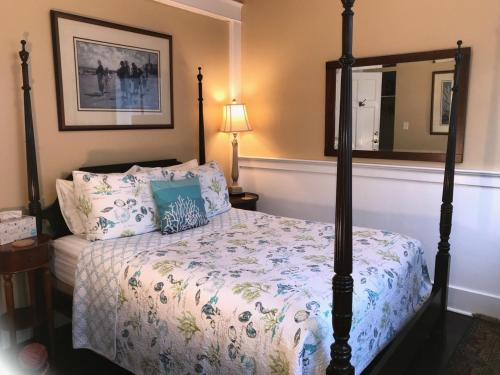 A bed or beds in a room at Inn at Harbour Village