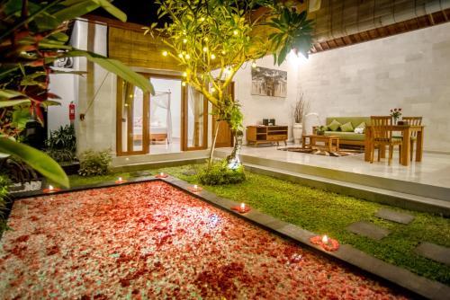 A garden outside Sandi Agung Villa Bidadari