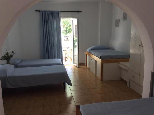 Ένα ή περισσότερα κρεβάτια σε δωμάτιο στο Sourmeli Garden Hotel