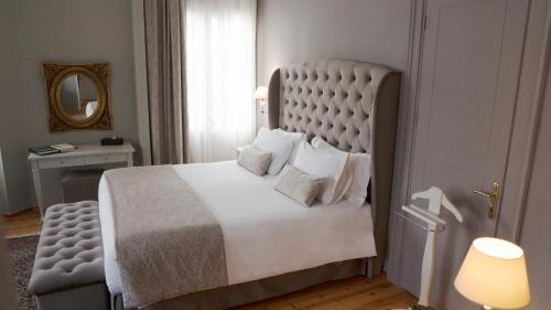 A bed or beds in a room at Capsis Bristol Boutique Hotel