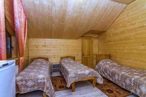 Кровать или кровати в номере Гостевой дом Любава
