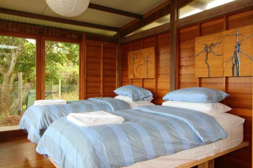 A bed or beds in a room at Delicate Nobby Artist Studio, 898 Point Plomer Road