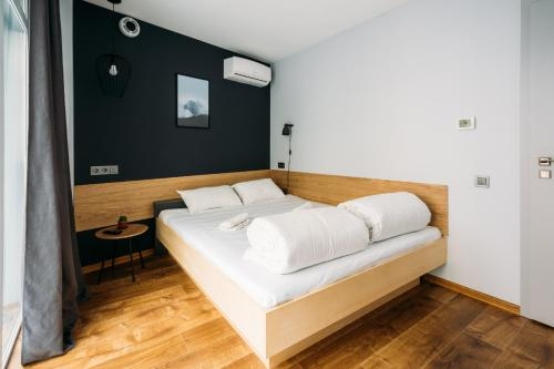 A bed or beds in a room at Yard Hostel & Coffee