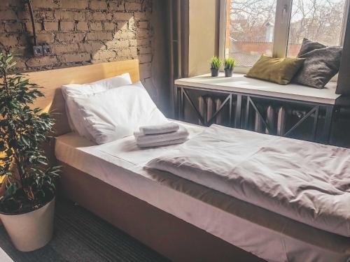 Кровать или кровати в номере Hide Hostel